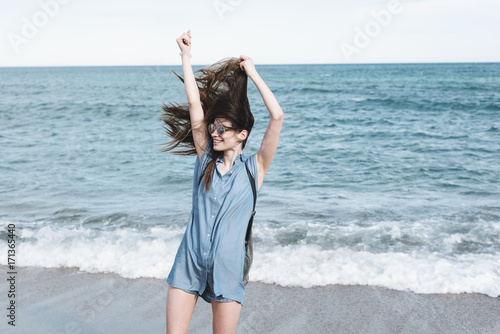 Young wild and free woman at the sea