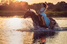 Girl Riding Horse Through Rive...