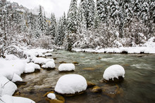 Snow Covered Rocks In A Cold M...