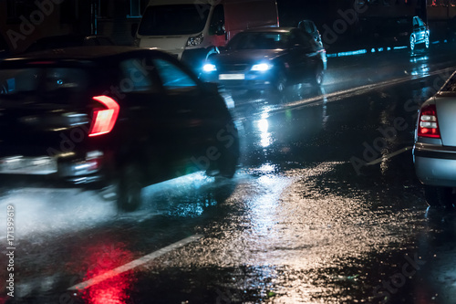 Fotobehang Tokyo car traffic during rainy night in city. blurred motion.