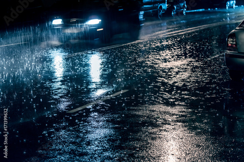 Fotobehang Tokyo cars driving on street during heavy rain at night, blurred view