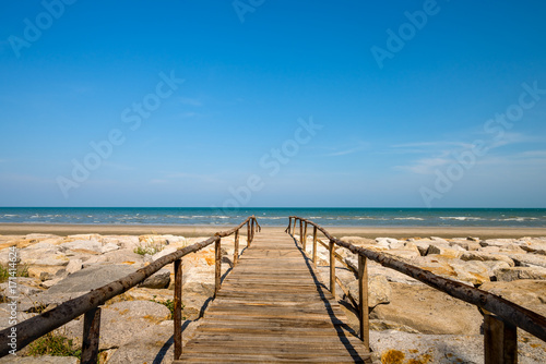 Wooden bridge walkway to the sea beach