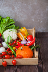 Fresh autumn vegetables in wooden box organic food