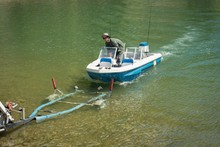 Man Moving Boat On Trailer At ...