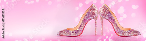 High heels shoes banner on blurred pink background