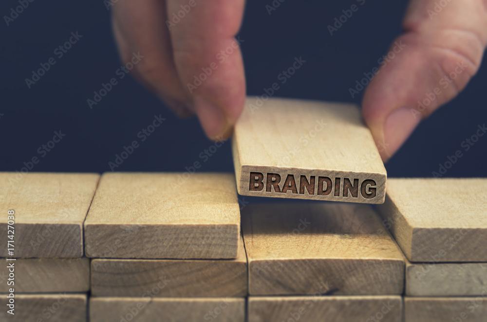 Branding word written on wooden block