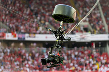 A Television Camera Hangs On Cables For Football Or A Concert