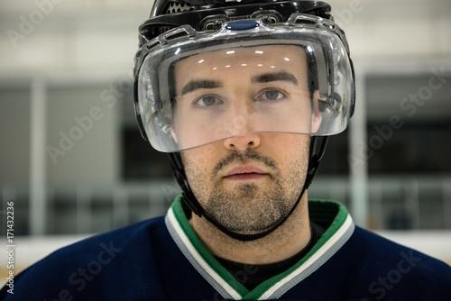 Portrait of ice hockey player wearing headwear