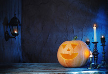 Halloween Pumpkins On Wooden T...