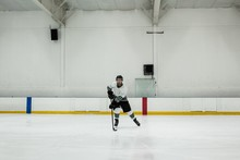 Male Player Practicing Ice Hockey