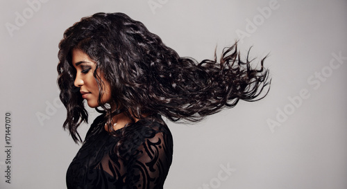 Foto op Plexiglas Kapsalon Brunette woman with long flying hair