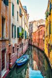 Fototapeta Uliczki - The old narrow street with a boat in Venice