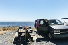 Picnic Table And Open Car At S...