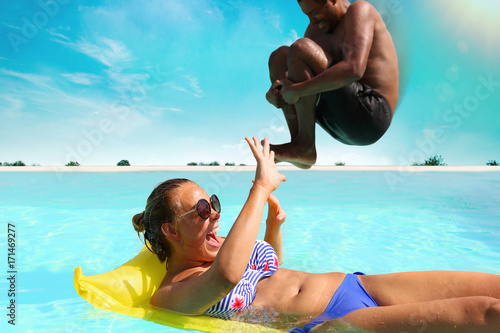 Photo  Jumping into swimming pool - Water bomb