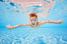 Happy Young Boy Swim And Dive ...