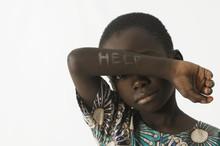 Littel African Boy Asks For He...