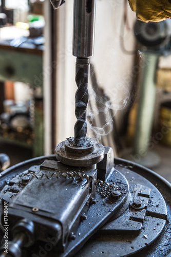 Drill close up - Close up drill tool in chuck during metal cutting process hole Poster