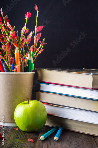 Concept Of Teachers Day Objects On A Chalkboard Background Books Green Apple