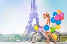 Girl Cycling Through Paris With Balloons Bouquet