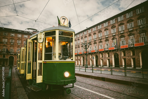 Vintage looking image of an historical tram waiting for passengers in Piazza Cas Plakát