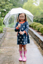 Cute Young Girl Standing In Th...