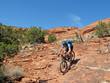 canvas print picture - Mountain biker in the red rocks, Sedona, Arizona, USA