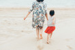 Cute toddler girl and her mother on the seaside