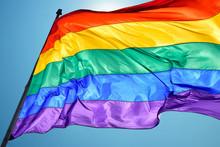 Rainbow Flag On Clear Sky Symb...