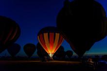 Hot Air Balloons Glowing At Ni...