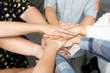 Team work concept. Business people joining hands