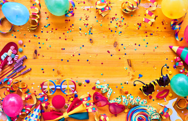 Colorful carnival accessories on table