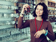 Girl seller offering fashionable bracelets and pendants