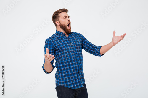 Young attractive bearded man singing loud Canvas Print