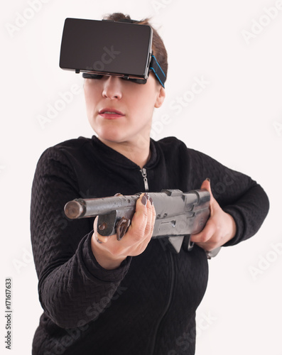 Woman play VR shooter game with vr glasses and rifle - Buy