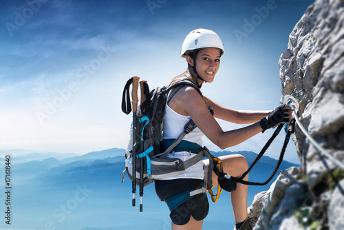 Tuinposter Alpinisme Woman climber on a Klettersteig (Via Ferrata)