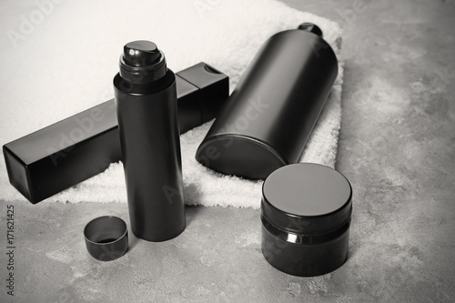 Photo Set for personal care with deodorant on gray table