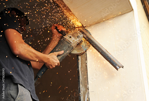 Fotografie, Obraz  Blacksmith cutting iron profiles with rotaflex