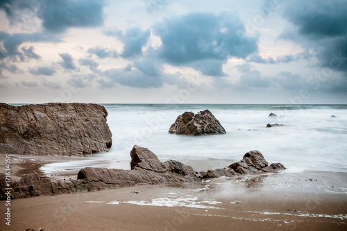 Sunset over Rocks at Widemouth Bay, Cornwall Canvas Print
