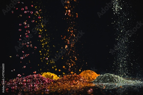 Powdered spices against black background