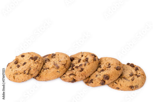 Tuinposter Koekjes Decorative border line of round cookies with chocolate flakes isolated over the white background.