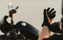 Motorcyclist Putting On Gloves