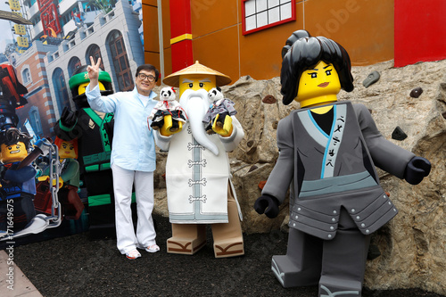 "Cast member Chan poses during a photo call for ""The LEGO Ninjago ..."