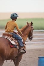 Boy Riding Horse Around Barrel