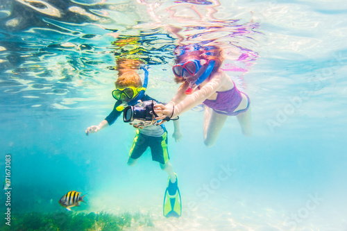 Boy And Girl Snorkeling On Tropical Reef In Cuba Caribbean Island With Underwater Camera
