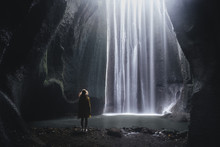 Woman Looking At The Waterfall At Cave