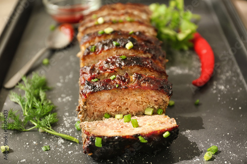 Tasty sliced turkey meatloaf on baking tray Canvas Print