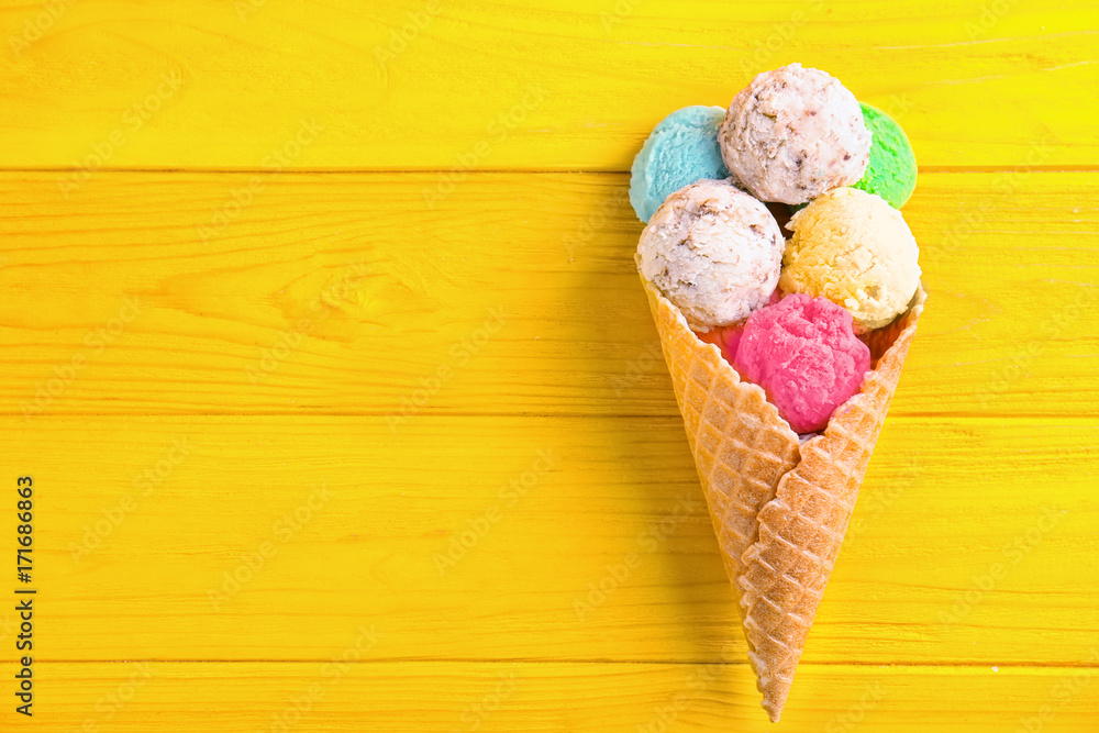 Fototapety, obrazy: Composition with colorful ice-cream scoops and waffle cone on wooden background