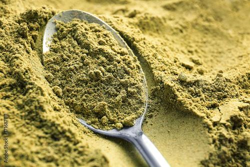 Fotobehang Fontaine Metal spoon in hemp protein powder, closeup