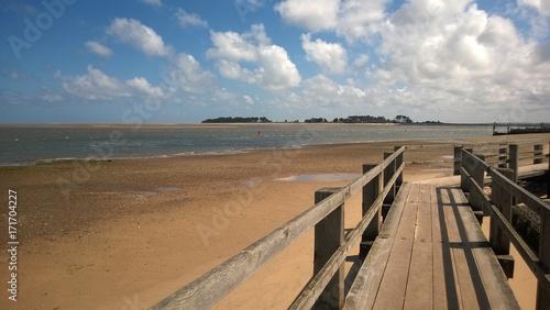 Leinwand Poster Wells on sea Norfolk East Anglia England view over bridge to sandy beach on Summ