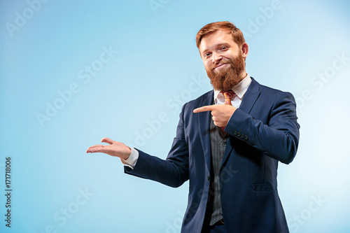 Fotografie, Obraz  Portrait of a business man isolated on blue background.